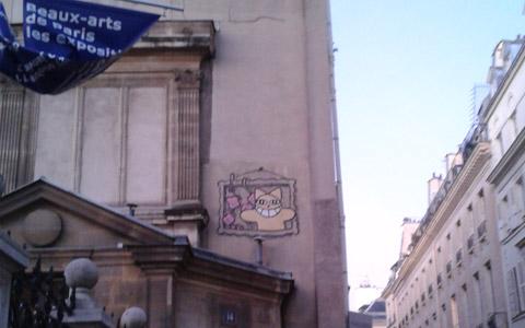 Street art à Paris - chat de cheshire