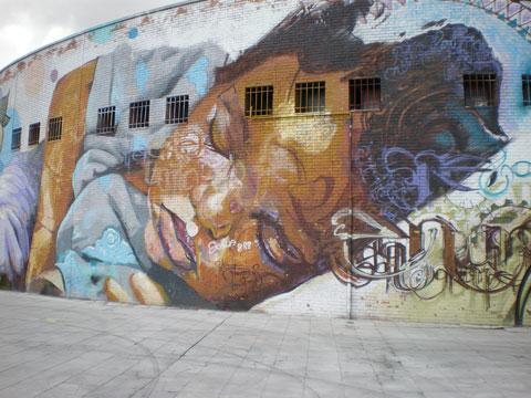 Street art à Séville - enfant endormi